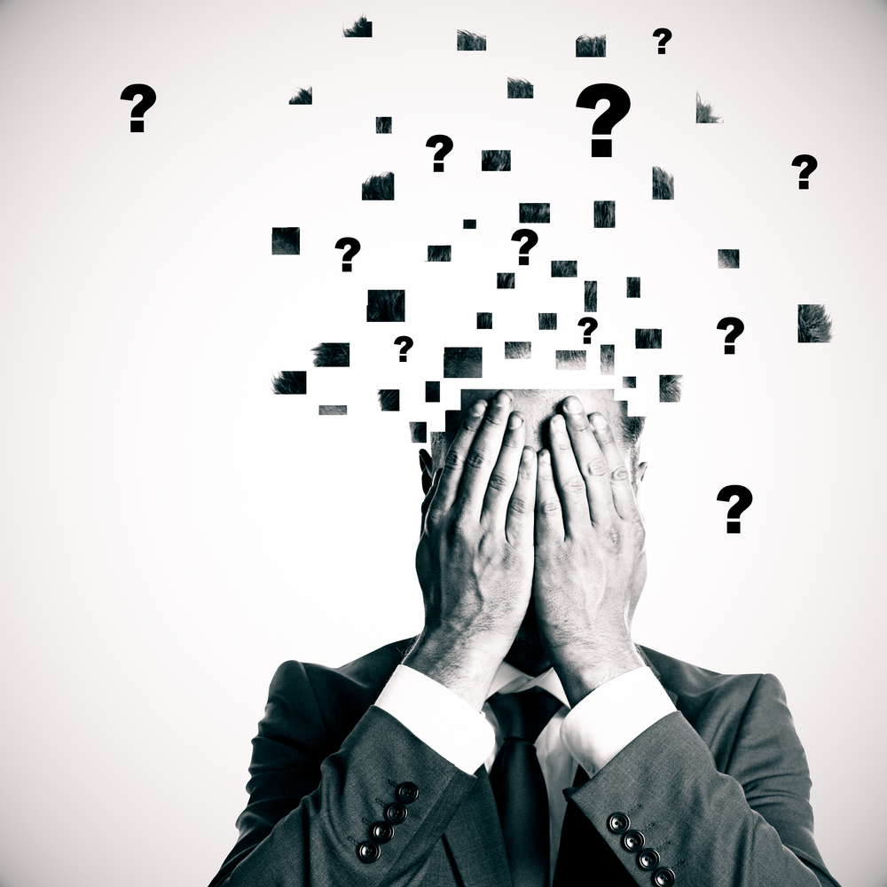 Man with brain exploding with question marks